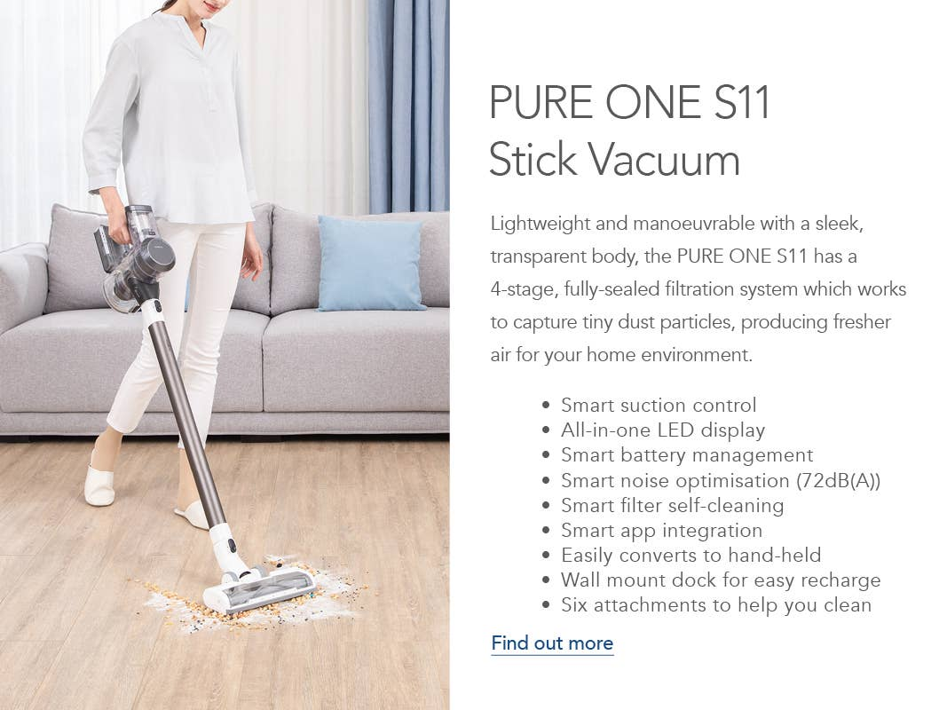 Woman cleaning food spilled on the floor with the Godfreys exclusive Tineco PURE ONE S11 Stick Vacuum